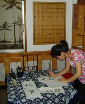 Christy writing Chinese calligraphy